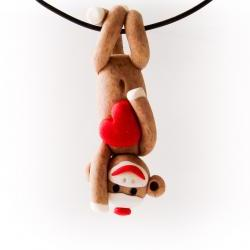 Brown Sock Monkey Pendant Swinging Upside Down holding a Valentine's Day Heart