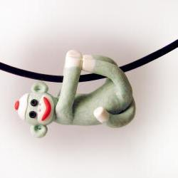 Green Sock Monkey Pendant Swinging from all fours handmade in Polymer Clay
